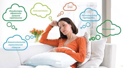 Женщина размышляет как уменьшить симптомы ПМС